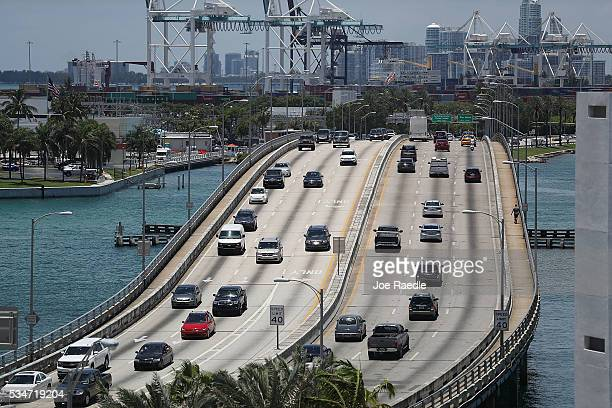 Vehicle traffic is seen in the street as people prepare for the Memorial Day weekend on May 27 2016 in Miami Beach Florida AAA is predicting 34...