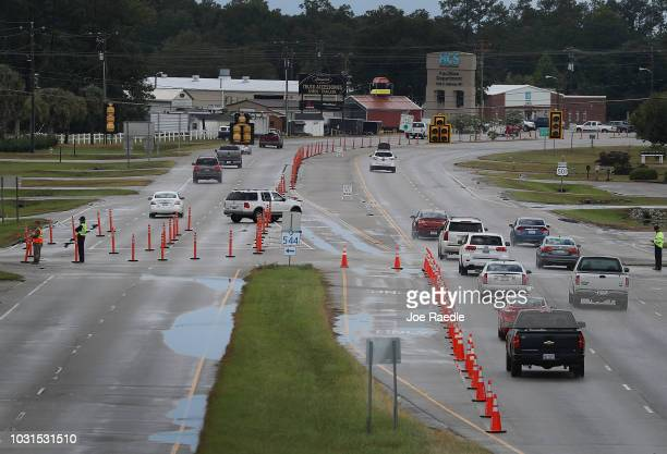 Vehicle traffic travels along US 501 as the South Carolina government ordered that traffic use all the lanes on the route leading away from the coast...
