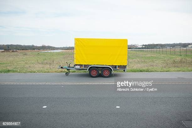 Vehicle Trailer On Road Against Sky