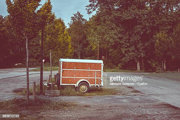 vehicle trailer on road against trees - albrecht schlotter stock photos and pictures