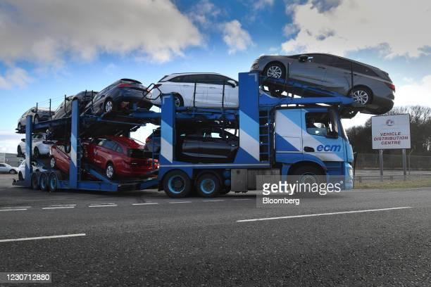 Vehicle transporter leaves the Vauxhall plant in Ellesmere Port, U.K., on Thursday, Jan. 21, 2021. Stellantis NV, the owner of Vauxhall and Opel...