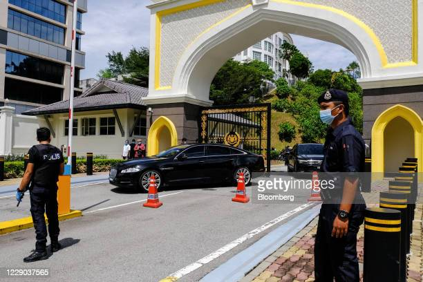A vehicle transporting Anwar Ibrahim founder and president of the People's Justice Party leaves the Istana Negara palace in Kuala Lumpur Malaysia on...