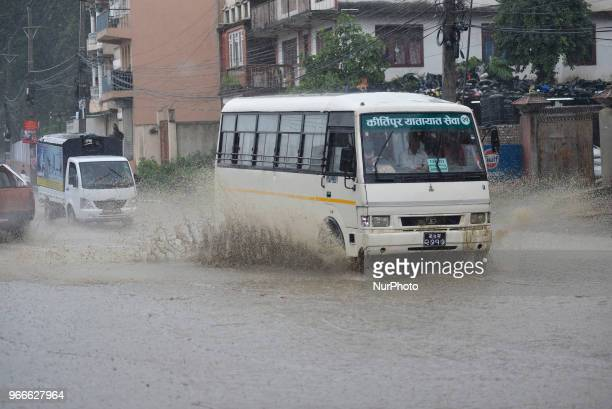 A Vehicle travelling through water logged road at Kathmandu Nepal on Sunday June 03 2018 Due to the poor water drainage management system yearly...