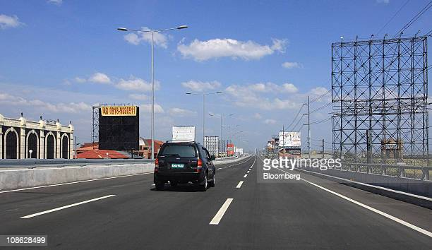 Vehicle travels along the newly constructed Skyway extension of the South Luzon Expressway in Manila, the Philippines, on Sunday, Jan. 30, 2011. The...