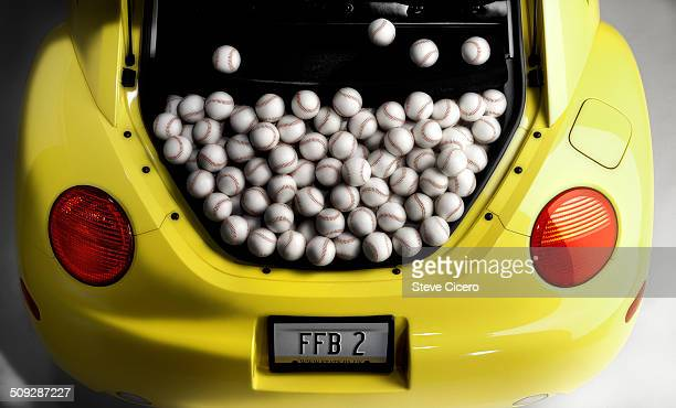 Vehicle trunk full of baseballs