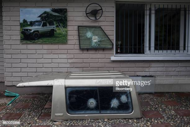 Vehicle windows with bullet holes are displayed at the Casa Museo Pablo Escobar in Medellin Colombia on Tuesday Oct 3 2017 In Colombia where more...