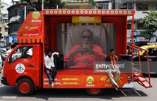 A vehicle with the images of late Shiv Sena patriarch Bal Thackeray during a rally in support of the party candidate from Dadar constituency Sada...