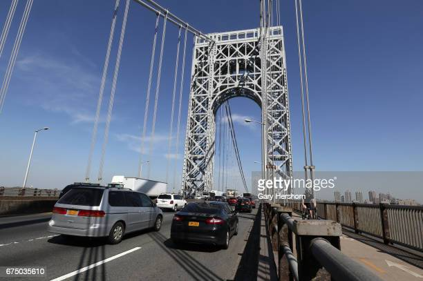 Vehicles and a cyclist cross over the George Washington Bridge on April 28 2017 in New York City