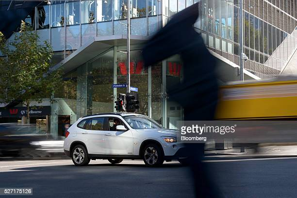 Vehicles and a pedestrian pass a Westpac Banking Corp branch in Melbourne Australia on Monday May 2 2016 Westpac which increased provisions for...