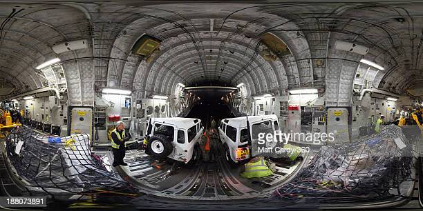 Vehicles and humanitarian aid are loaded onto a C17 aircraft operated by No 99 Squadron at RAF Brize Norton on November 15 2013 in Brize Norton...