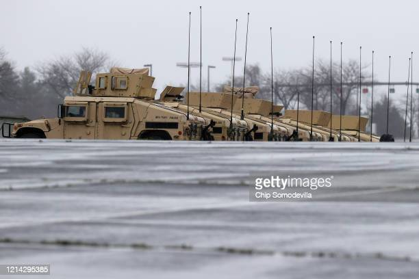 Vehicles and other equipment from the Maryland National Guard occupy a section of parking lot on the south side of FedEX Field that officials said...