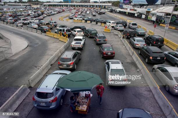 Vehicles and pedestrian crossing lines are seen on the Mexican side of the San Ysidro Port of Entry on November 1 in Tijuana northwestern Mexico...