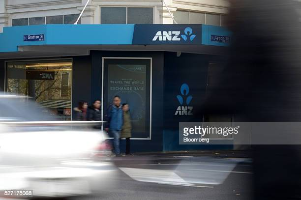 Vehicles and pedestrians pass an Australia New Zealand Banking Group Ltd branch in Melbourne Australia on Monday May 2 2016 ANZ is scheduled to...