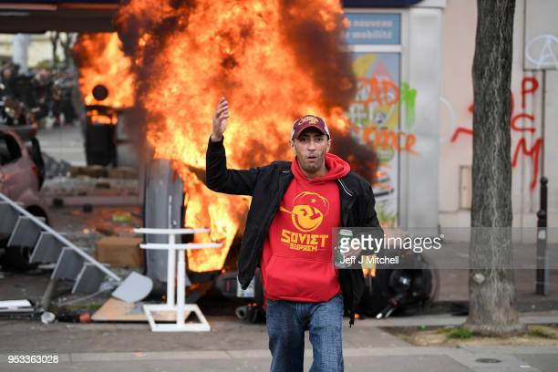 Vehicles are burning as thousands of people take to the streets during the May Day demonstrations on May 1 2018 in Paris France This month celebrates...