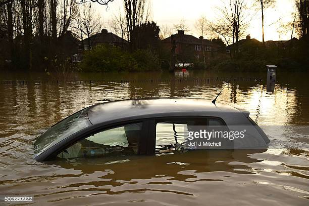 Vehicles are inundated as flood waters begin to recede in the Huntington Road area of York after the River Foss burst its banks on December 28 2015...