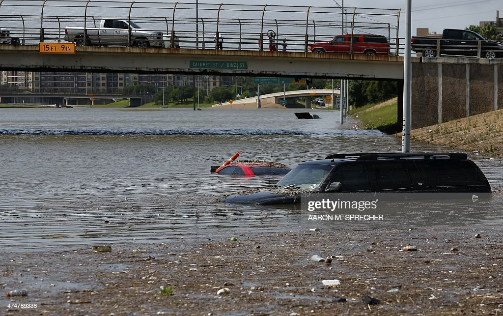 Vehicles are left stranded on Texas State Highway 288 in Houston, Texas on May 26, 2015. Heavy rains throught Texas put the city of Houston under massive amounts of water, closing roadways and trapping residents in their cars and buildings, according to local reports. Rainfall reached up to 11 inches (27.9cm) in some parts of the state, according to national forecasters, and the heavy rains quickly pooled over the state's already saturated soil.