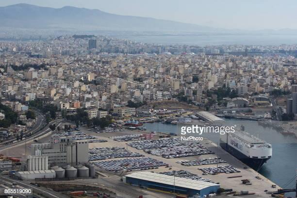 Vehicles are parked at a cargo terminal at Piraeus port, near Athens. Greece, Monday, October 23, 2017