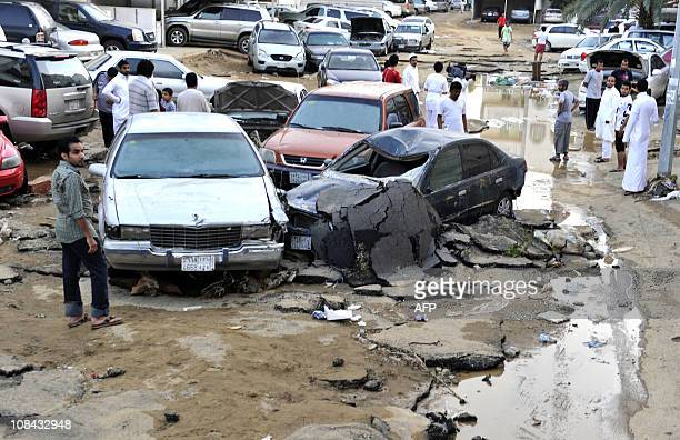 Vehicles are piled up and tarmac torn up following heavy rains and floods in the city of Jeddah on January 27 as Saudi emergency services mounted a...