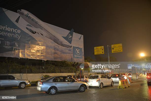 Vehicles are seen at the entrance of the Benazir International Airport following the reports of a plane crash at Havelian in Abbottabad district in...