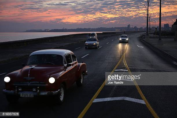 Vehicles are seen driving along the Malecon as Cuba prepares for the visit of US president Barack Obama on March 18 2016 in Havana Cuba Mr Obama's...