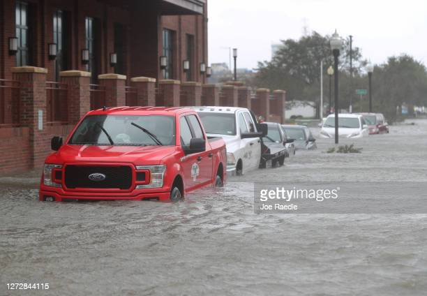 Vehicles are seen in a flooded street as Hurricane Sally passes through the area on September 16, 2020 in Pensacola, Florida. The storm is bringing...