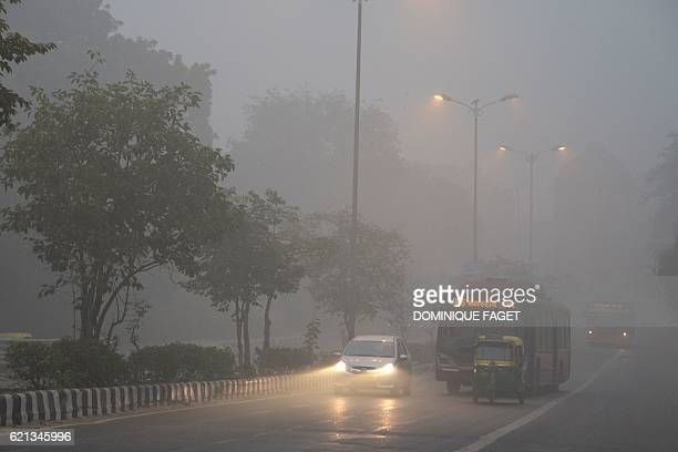 Vehicles are seen in heavy smog in New Delhi on November 6 2016 Thick smog has blanketed the capital for days with local and central authorities...