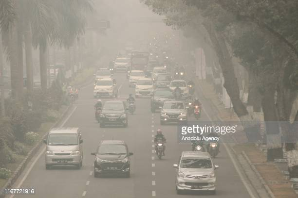 Vehicles are seen passing on highway in thick haze that surrounds Pekanbaru City Riau Province Indonesia on September 13 2019 According to the...