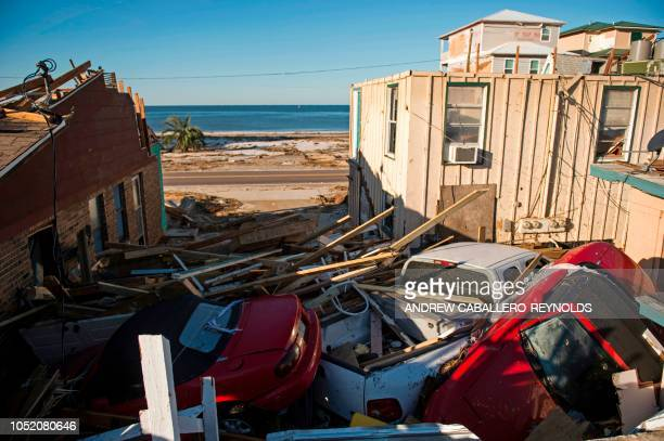 TOPSHOT Vehicles are seen pushed into a house by storm surge in Port St Joe beach Florida on October 13 three days after hurricane Michael hit the...