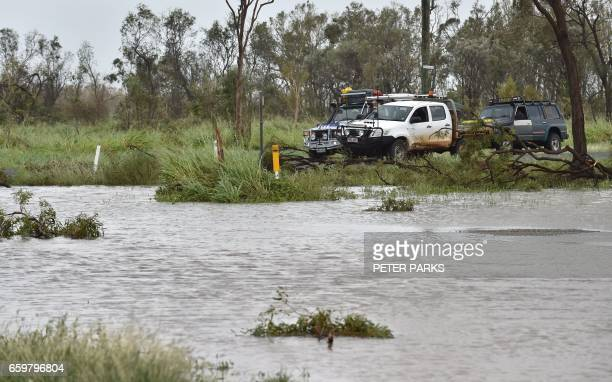 Vehicles are stopped by floodwaters near the Queensland town of Bowen on March 29 after the area was hit by Cyclone Debbie Towns remained cut off in...