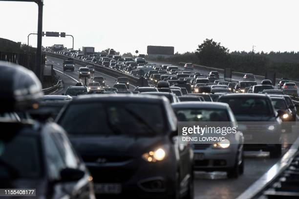 Vehicles are stuck in a several kilometrelong traffic jam at Zagreb tollgate on July 13 as people go on holidays The country of 42 million is...