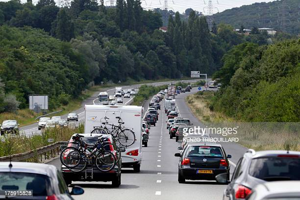 Vehicles are stuck in a traffic jam on August 10 2013 near Thiais outside Paris The day is classified by Bison Fute the French Traffic forecasters as...