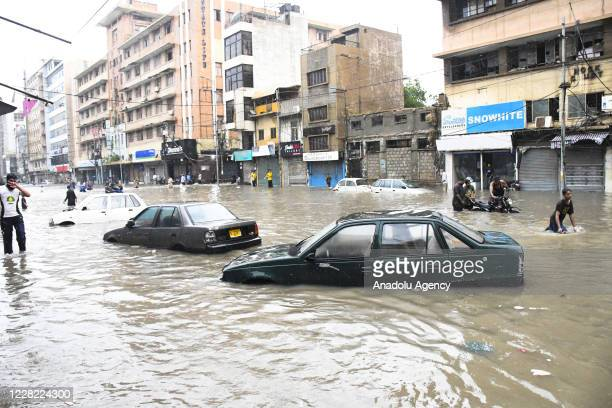Vehicles are submerged in a flooded street after heavy monsoon rains in Pakistan's port city of Karachi on August 27, 2020.