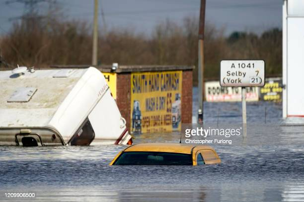 Vehicles are submerged in floodwater in the village of Snaith after the River Aire bursts its banks on March 02 2020 in Goole England Flooding from...