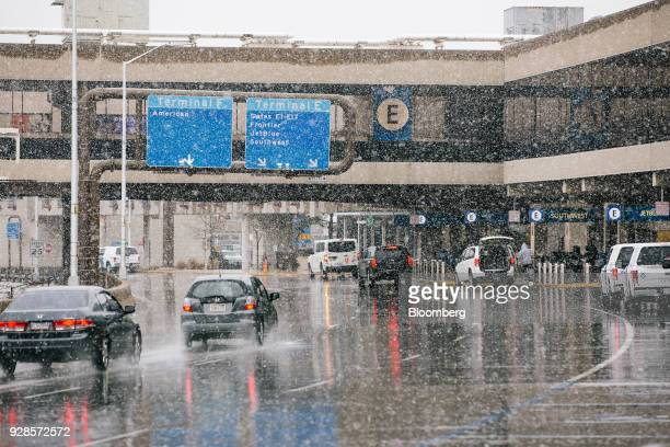 Vehicles arrive at departures area of Philadelphia International Airport during Winter Storm Quinn in Philadelphia Pennsylvania US on Wednesday March...