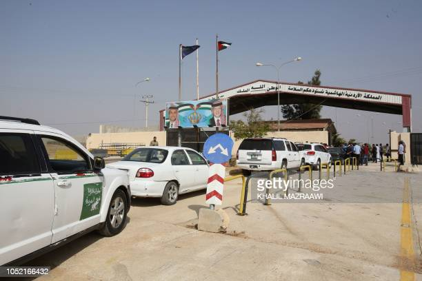 Vehicles arrive at the Jaber border crossing between Jordan and Syria on the day of its reopening on October 15 2018 in the Jordanian Mafraq...