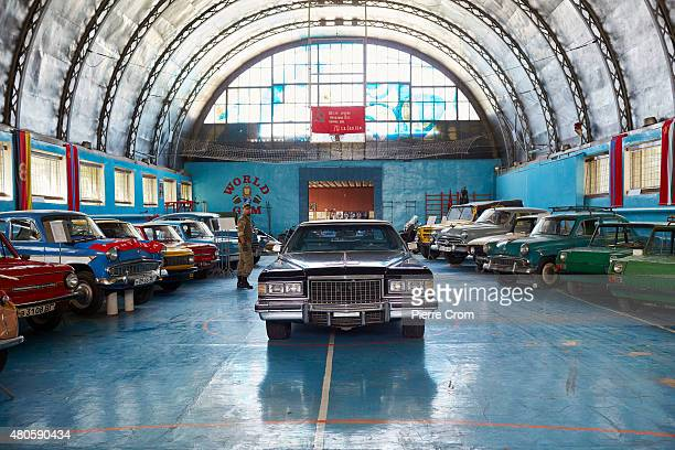 Vehicles believed to be from the Luhansk car museum sit in the base of the Luhansk chapter of the Night Wolves motorcyle club who fight on the side...