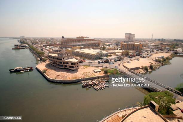 Vehicles belonging to the engineering department of the Hashed alShaabi paramilitary forces are pictured as they arrive in the southern Iraqi city of...