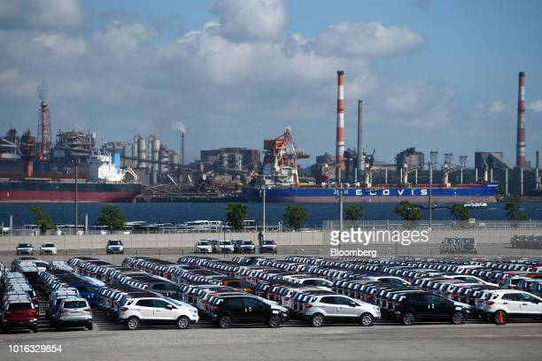 Vehicles bound for shipment sit at the Nagoya Port in Nagoya Japan on Tuesday July 31 2018 Japan is scheduled to release trade balance figures for...