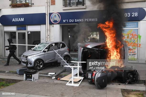 Vehicles burn as thousands of people take to the streets during the May Day demonstrations on May 1 2018 in Paris France This month celebrates the...