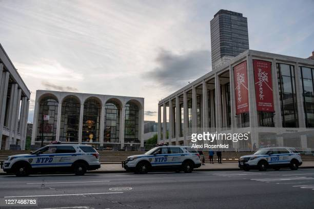 NYPD vehicles can be seen in front of a closed Lincoln Center for the Performing Arts son May 27 2020 in New York City Government guidelines...