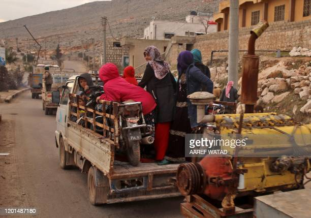 Vehicles carrying internally-displaced persons and their belongings drive through the town of Darret Ezza, about 30 kilometres northwest of the...