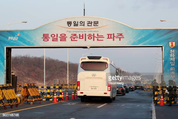 Vehicles carrying South Korean delegates including Cho Myounggyon South Korea's unification minister pass a military check point on the Unification...