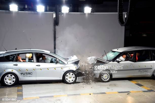 Vehicles collide during a frontal crash test without a safety belt buckled in the back seat as part of France's Road Safety Commission's campaign...
