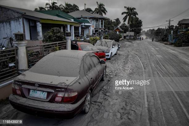 Vehicles covered in volcanic ash from Taal Volcano's eruption are seen on January 13 2020 in Lemery Batangas province Philippines The Philippine...