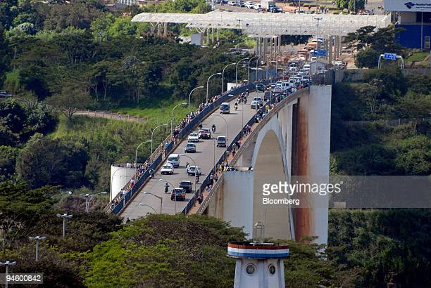 Vehicles cross the Ponte da Amizade Friendship Bridge border crossing between Brazil and Paraguay in Foz do Iguacu Brazil on May 10 2007 In a parking...