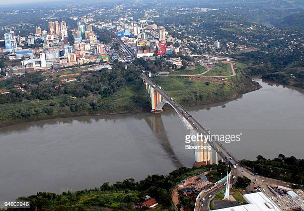 Vehicles cross the Ponte da Amizade Friendship Bridge border crossing between Brazil and Paraguay in Foz do Iguacu Brazil on May 9 2007 In a parking...