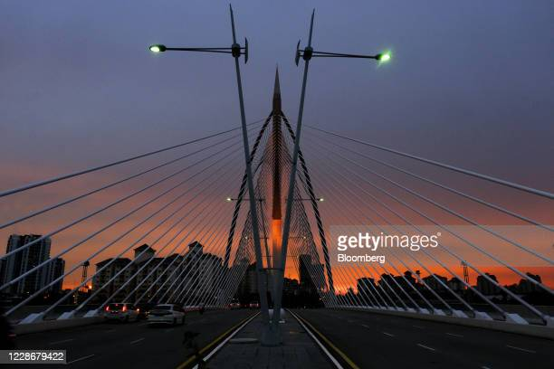 Vehicles cross the Seri Wawasan Bridge in Putrajaya Malaysia on Wednesday Sept 23 2020 Malaysia's Prime Minister Muhyiddin Yassin urged people to...