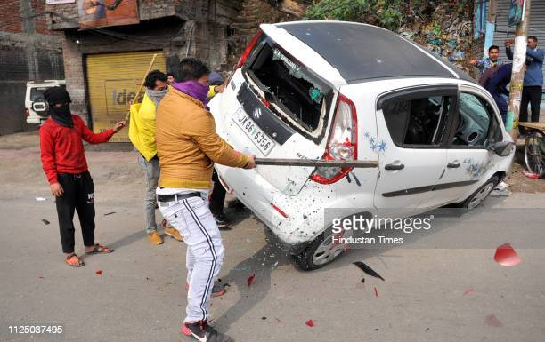 Vehicles damaged by an angry mob during a protest against the killing of CRPF personnel in the Pulwama terror attack on February 15 2019 in Jammu...
