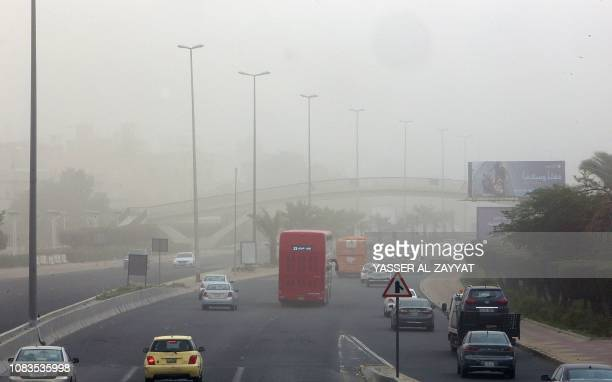 Vehicles drive along a highway during a dust storm in Kuwait City on January 17 2019 Visibility levels in some areas dropped to less than 600 metres