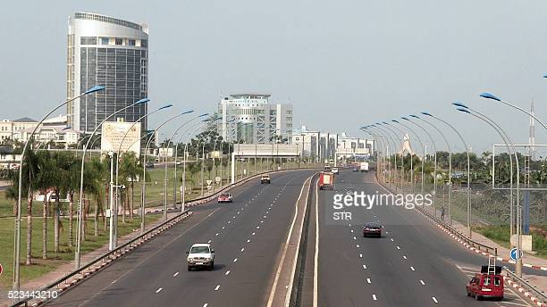 Vehicles drive along a main thoroughfare in the Equatorial Guinea capital Malabo on April 22 2016 / AFP / STR